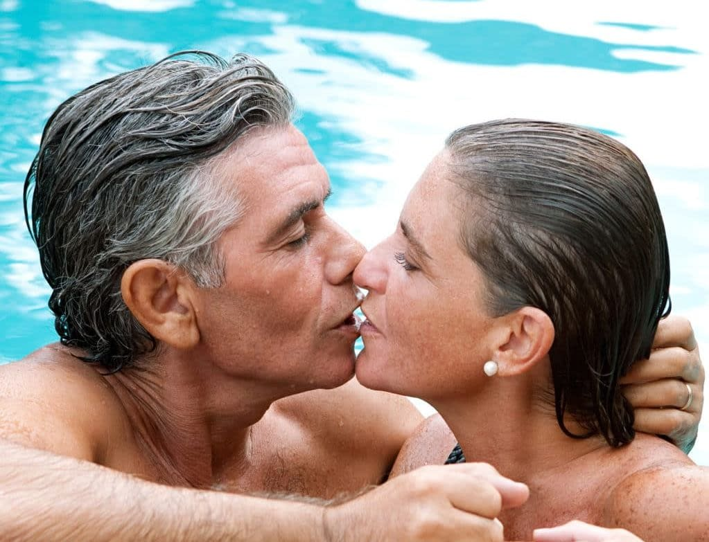 happy husband and wife kissing