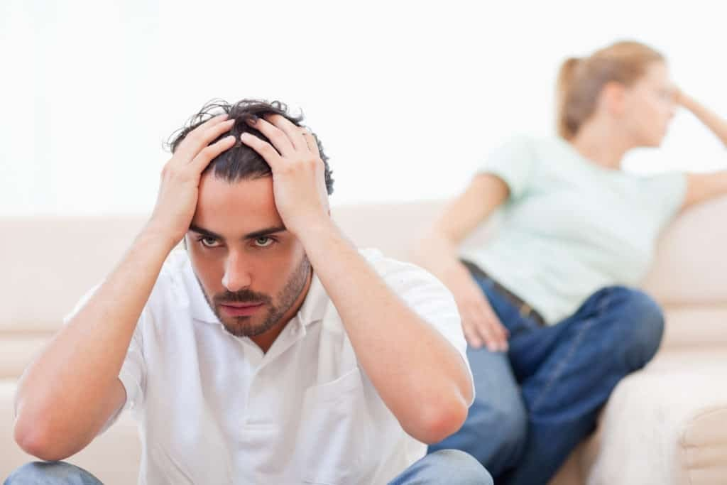 man stressed out with wife and struggling relationship